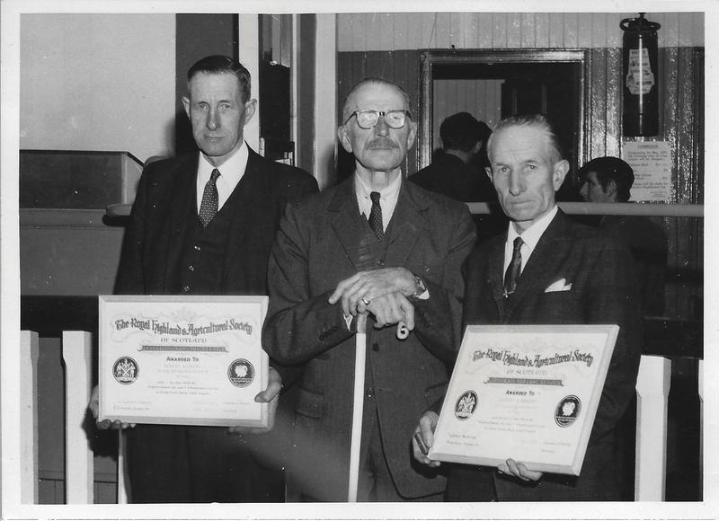 RMC_22 Photo of Gilbert and Robert Murray receiving their RHAS certificates..jpg
