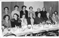 15 women at table in hall