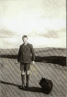 Peter Kelly with one of the teachers dogs at Clatteringshaws School circa 1940