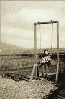 Jean Kelly on the swing at Clatteringshaws School circa 1940